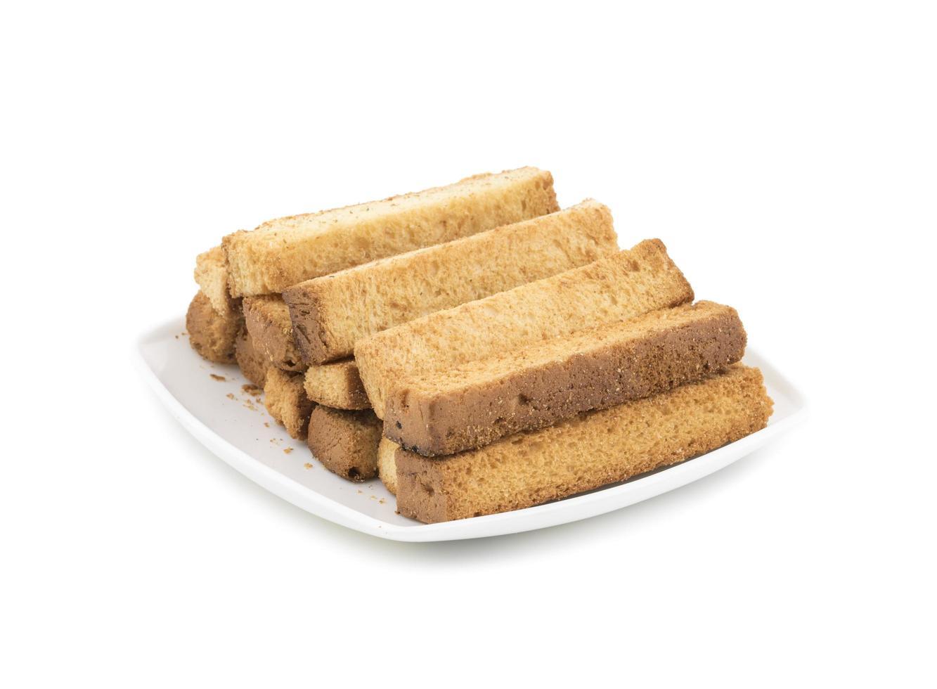 toast stokken op een witte plaat foto