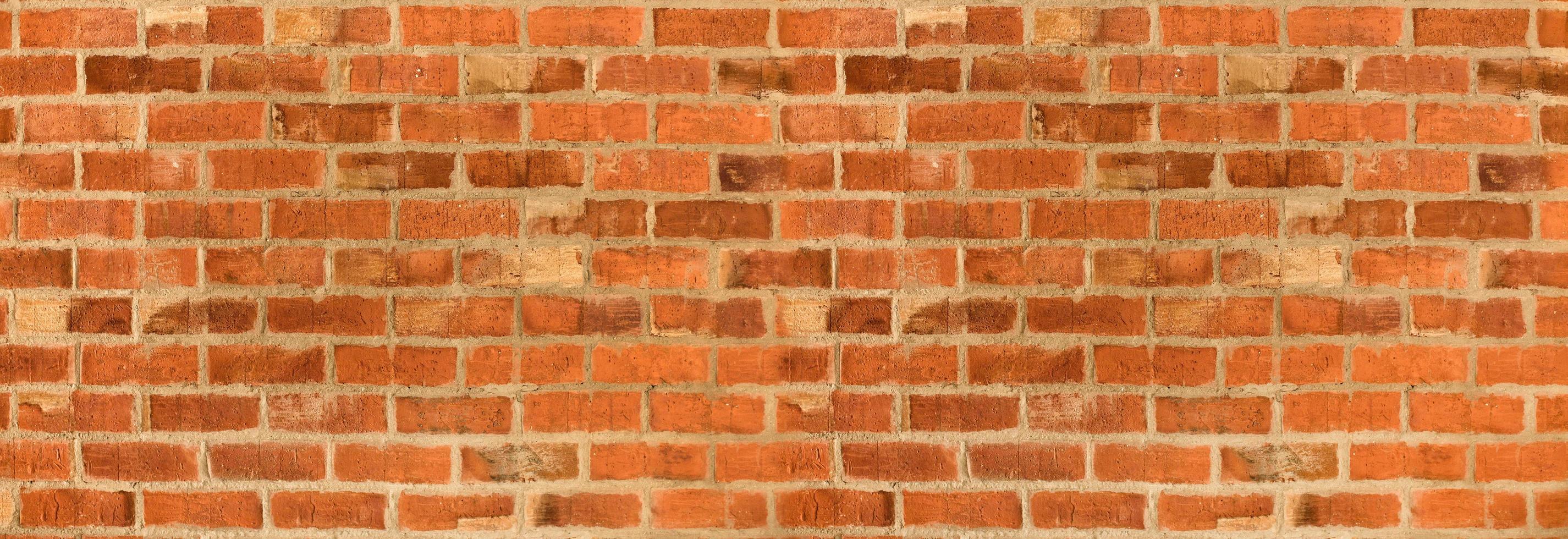 panorama van oranje bakstenen muur textuur of achtergrond foto