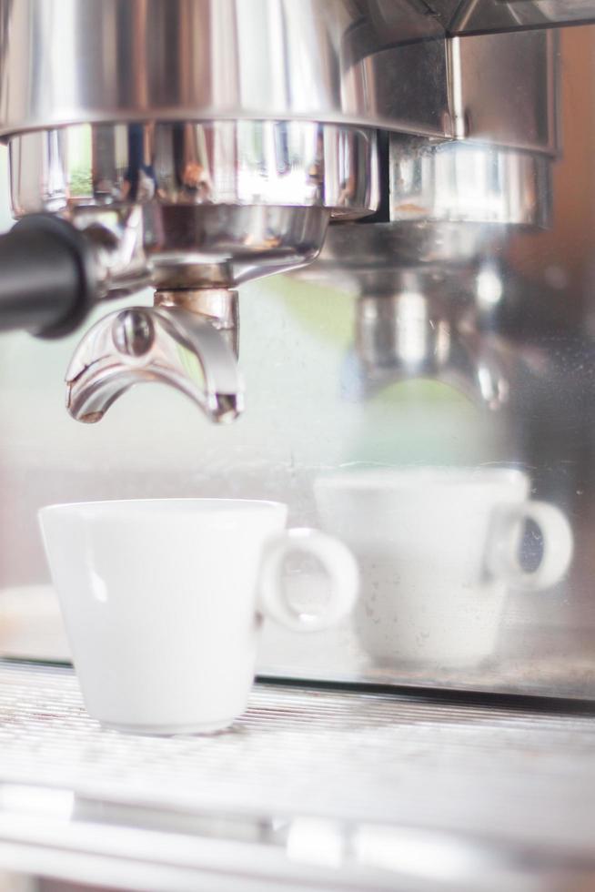 espressomachine en een kopje foto