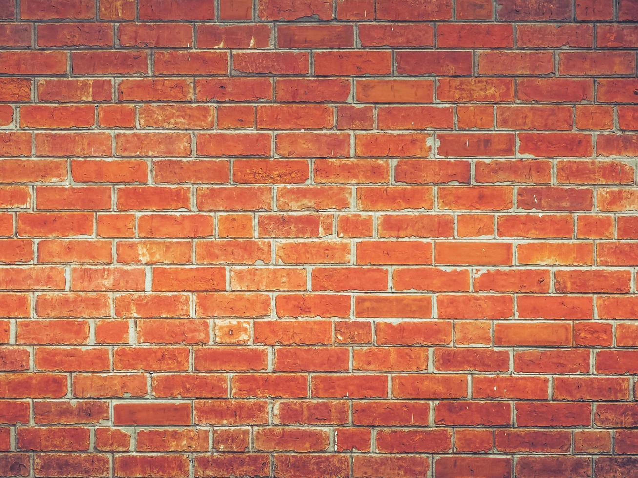 rode bakstenen muur met licht foto
