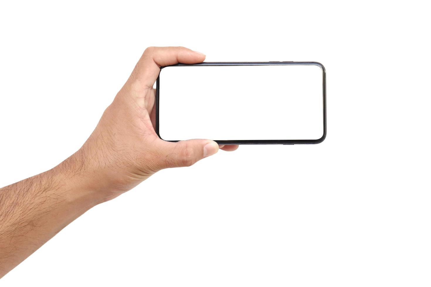 internetcommunicatie en reclame-ideeën, de hand houdt het witte scherm vast, de mobiele telefoon is geïsoleerd op een witte achtergrond met het uitknippad foto
