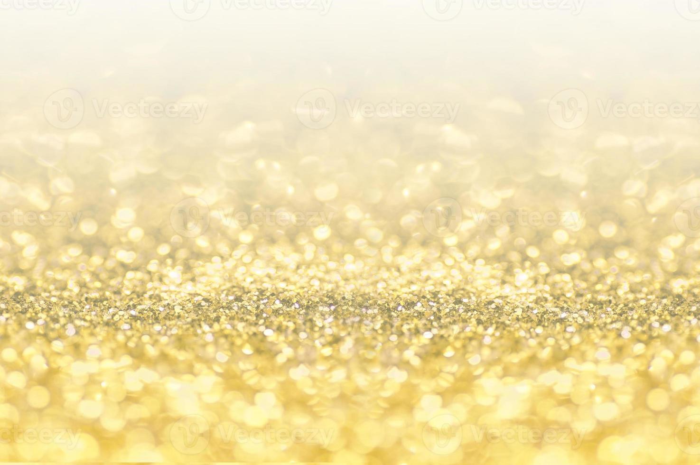 gouden mousserende en bokeh achtergrond foto