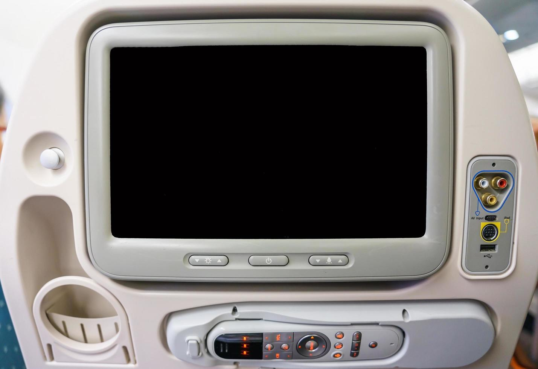 privémonitor in vliegtuigstoel foto