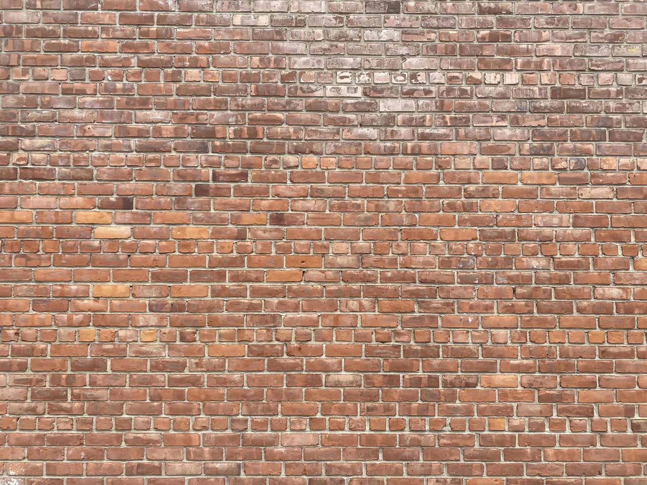 oude muur met bruine bakstenen foto