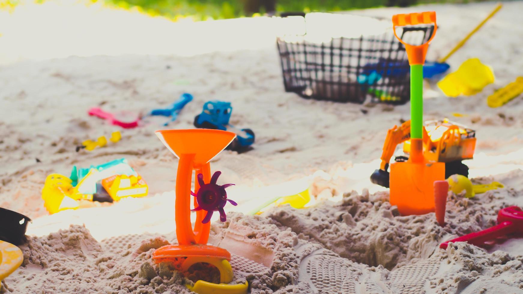 zand en speelgoed zomer achtergrond foto