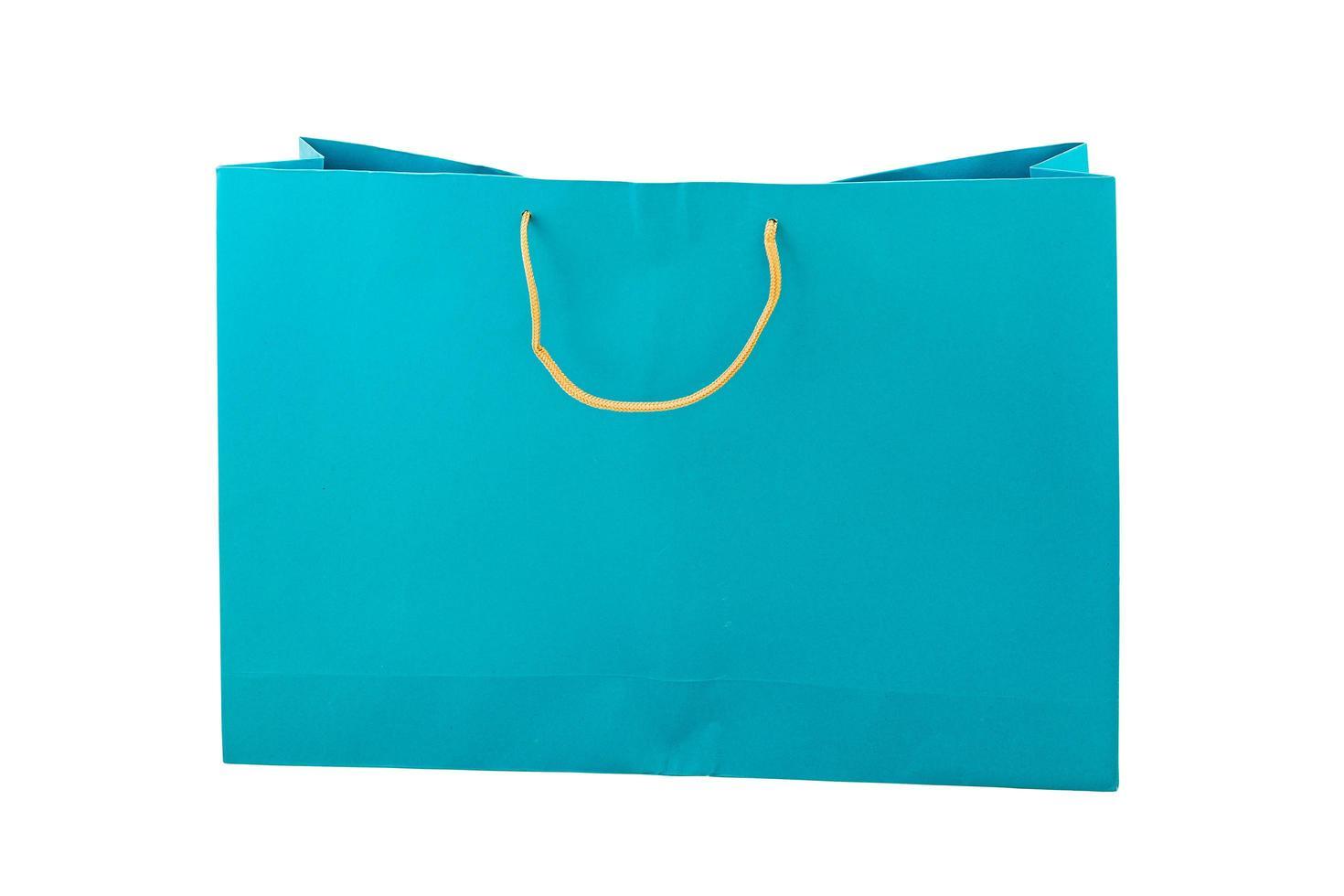 blauwe papieren zak geïsoleerd op een witte achtergrond foto