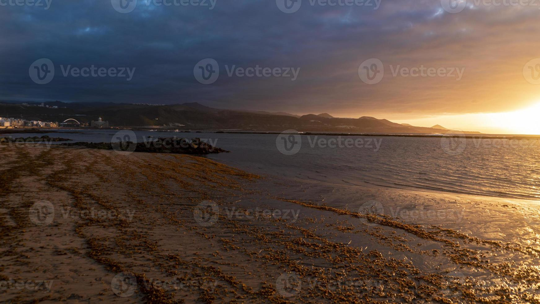 zonsondergang in las palmas -canteras strand foto