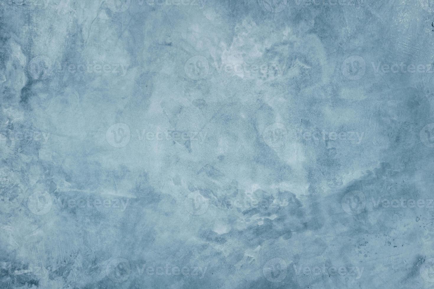 blauwe cementmuur met donkere textuurachtergrond foto