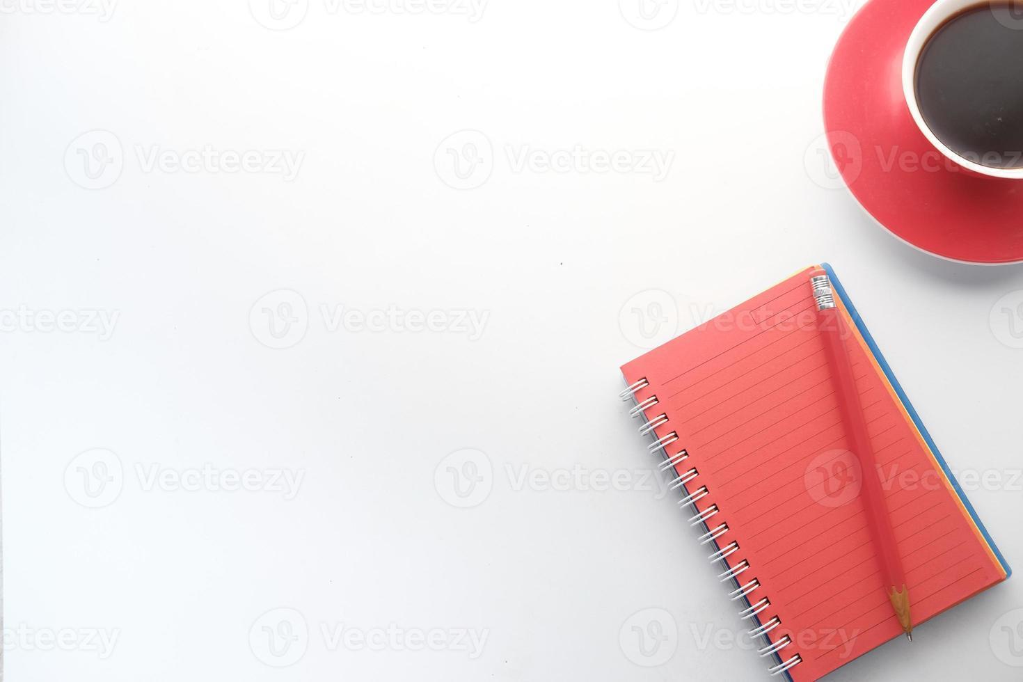 rode notebook met kopie ruimte foto