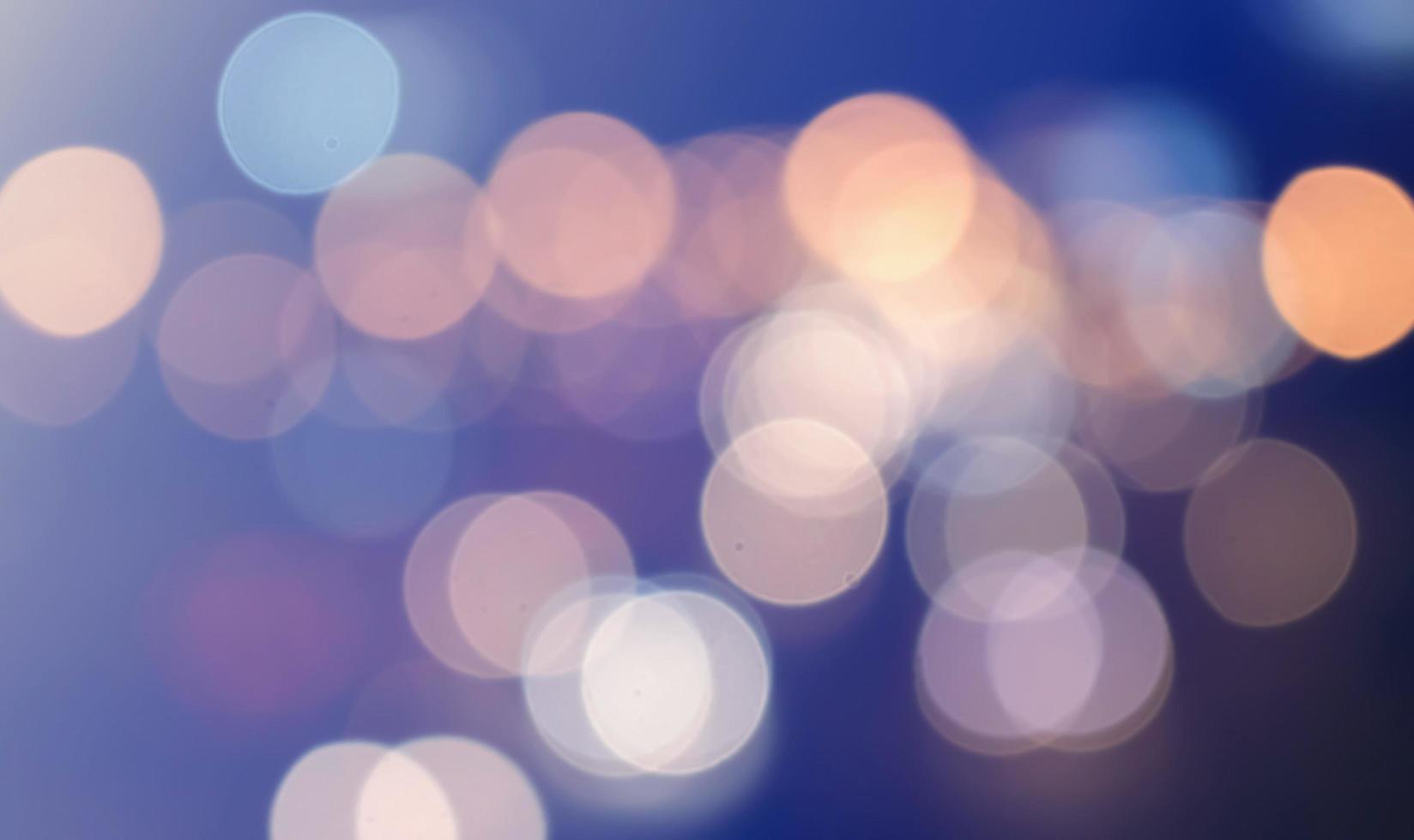 bokeh cirkelvormig licht, sprankelend verkeerslichtglinstering foto