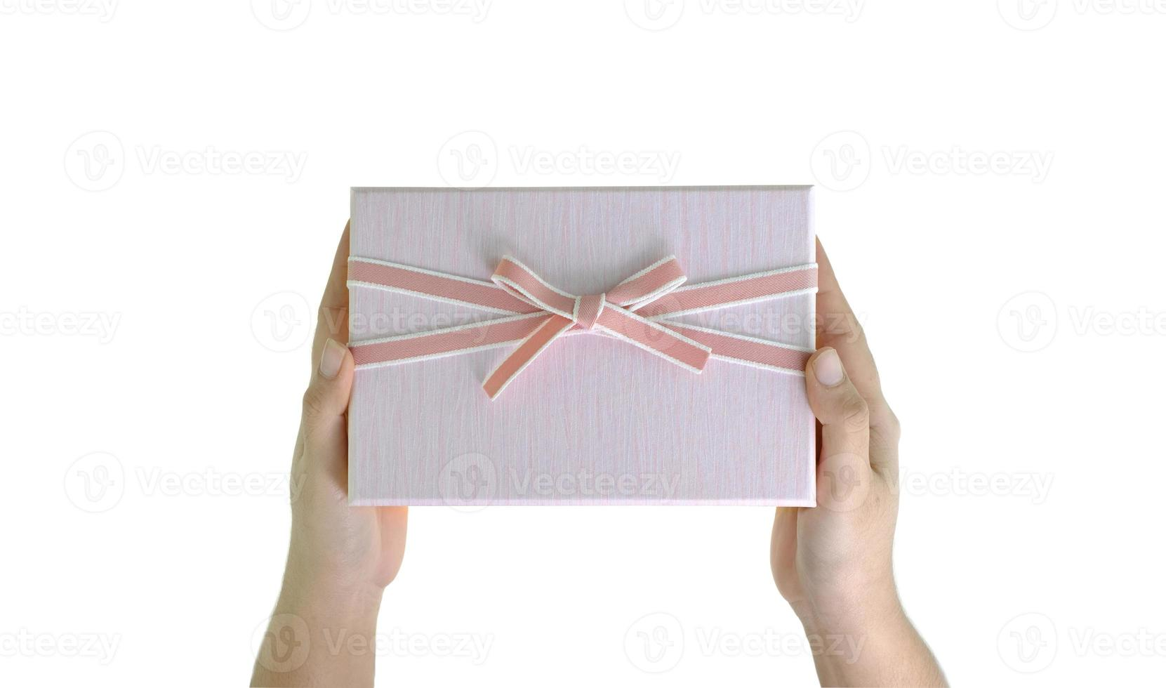 hand met geschenkdoos foto