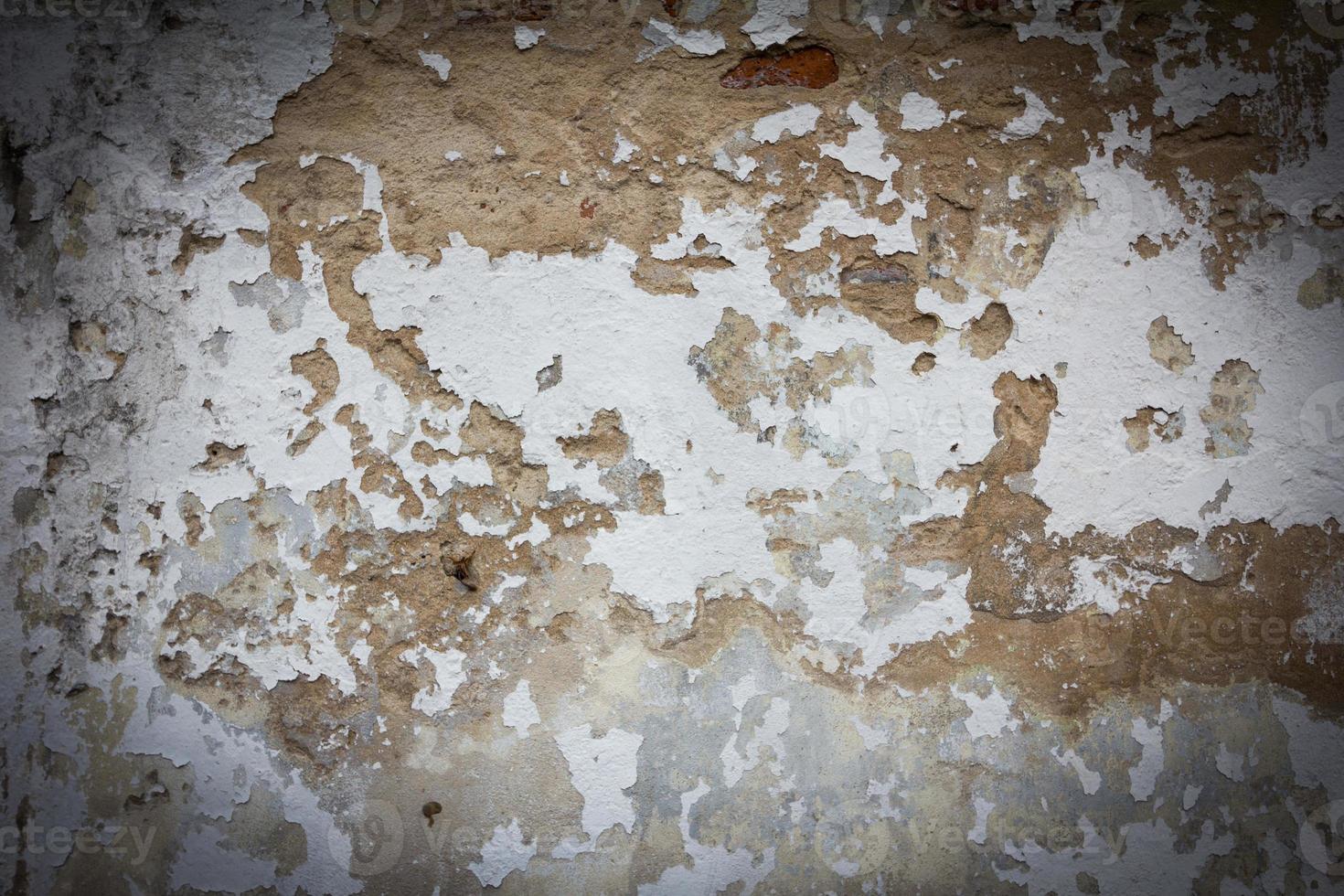 oude muur textuur grunge achtergrond en zwart vignet foto