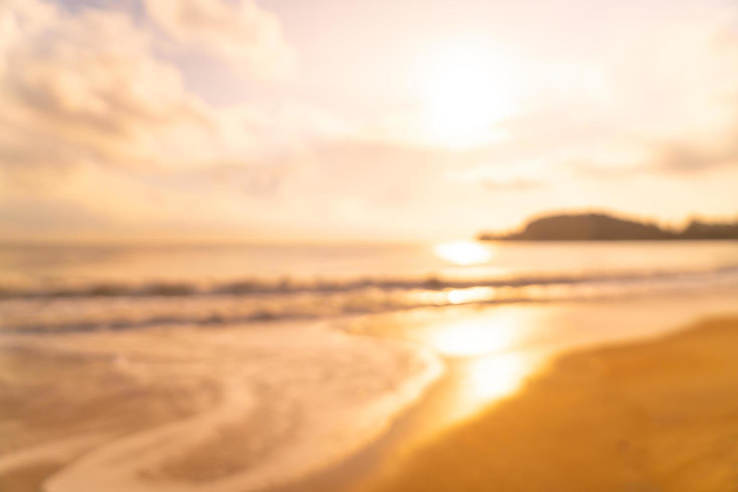 abstract vervagen strand zee bij zonsopgang of zonsondergang tijd voor achtergrond foto