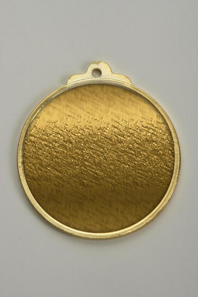medaillon gemaakt van goud, zilver en brons foto