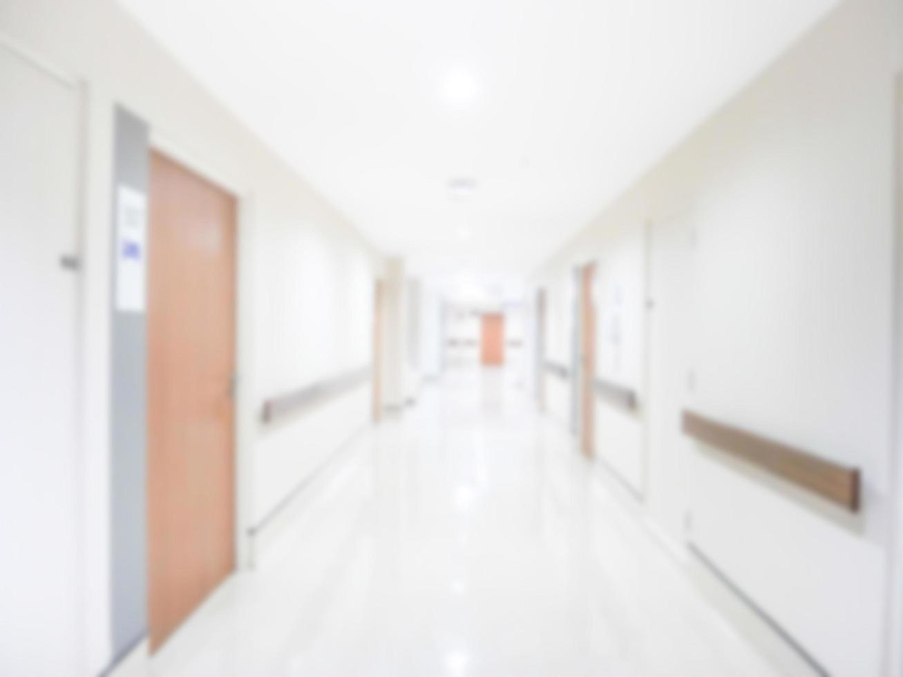 abstract vervagen gang van het ziekenhuis, wazig beeld achtergrond van gang in ziekenhuis foto