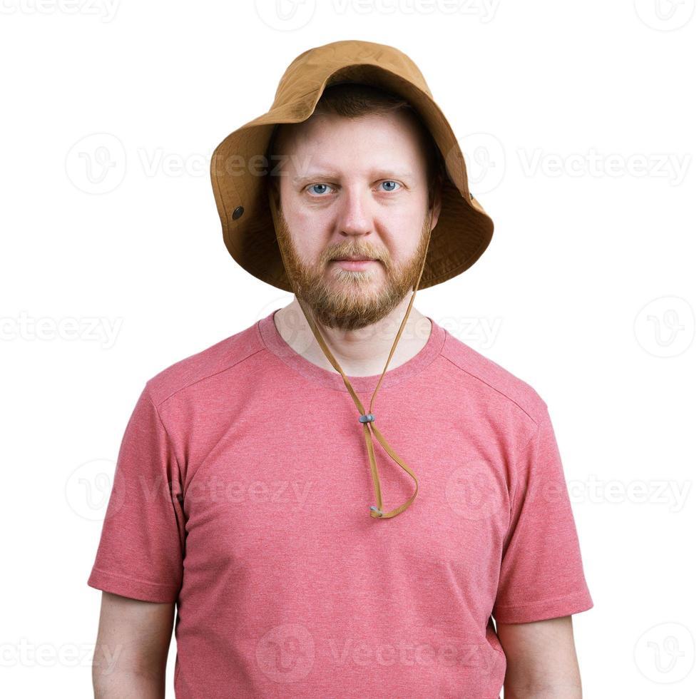 bebaarde jonge man in een panama foto