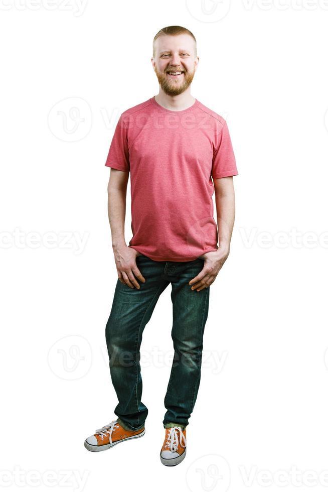 bebaarde jonge man in een t-shirt en jeans foto