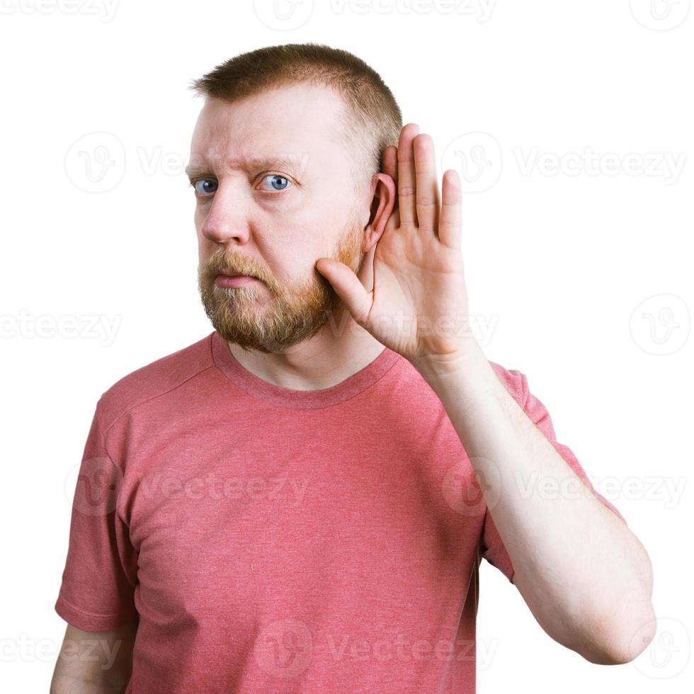 man met een baard luistert naar iets foto