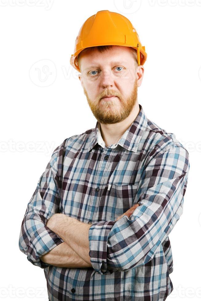 arbeider in oranje helm en geruit overhemd foto