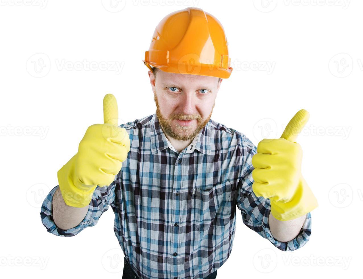 man in een oranje bouwhelm en handschoenen foto