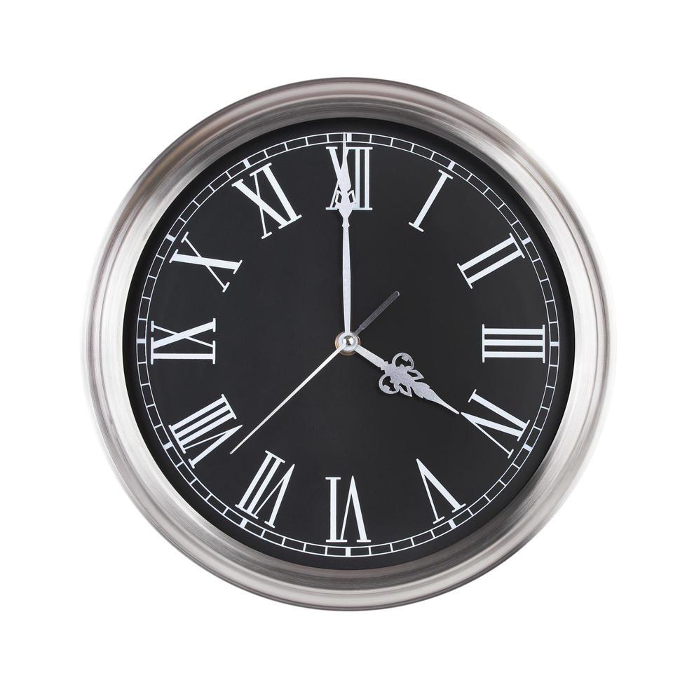 vier uur op de ronde klok foto