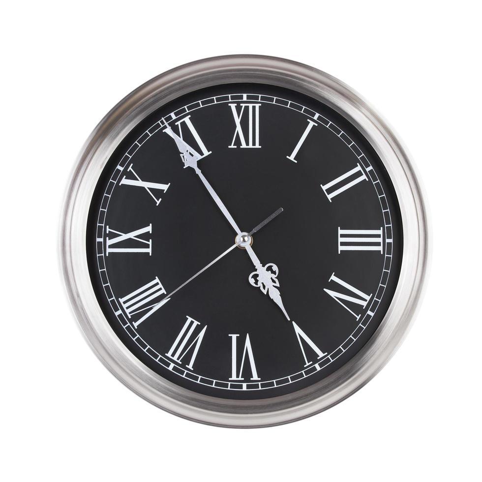 ronde klok geeft bijna vijf uur aan foto