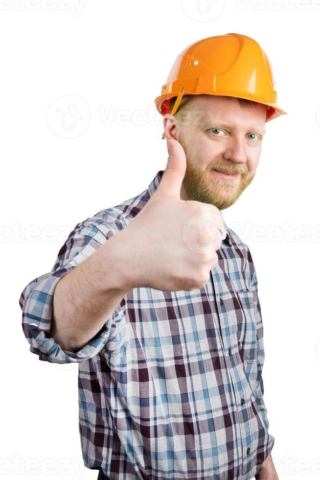 man in een helm laat zien dat alles in orde is foto