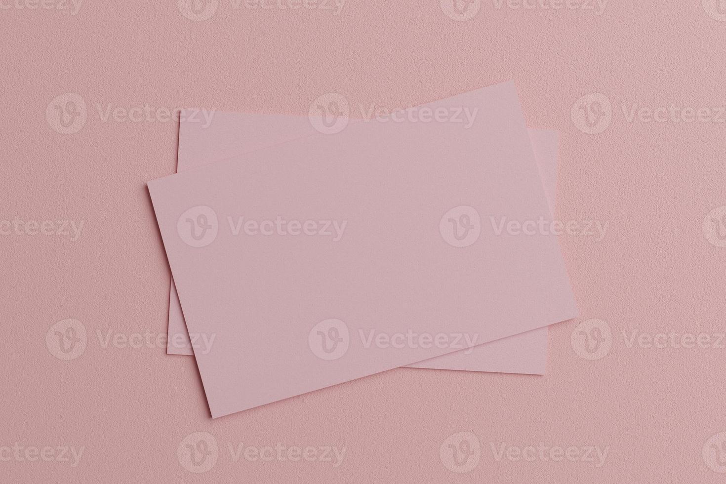 roze pastel visitekaartje papieren mockup sjabloon met lege ruimte omslag voor invoegen bedrijfslogo of persoonlijke identiteit op kartonnen achtergrond. modern stijlconcept. bovenaanzicht. 3d illustratie render foto