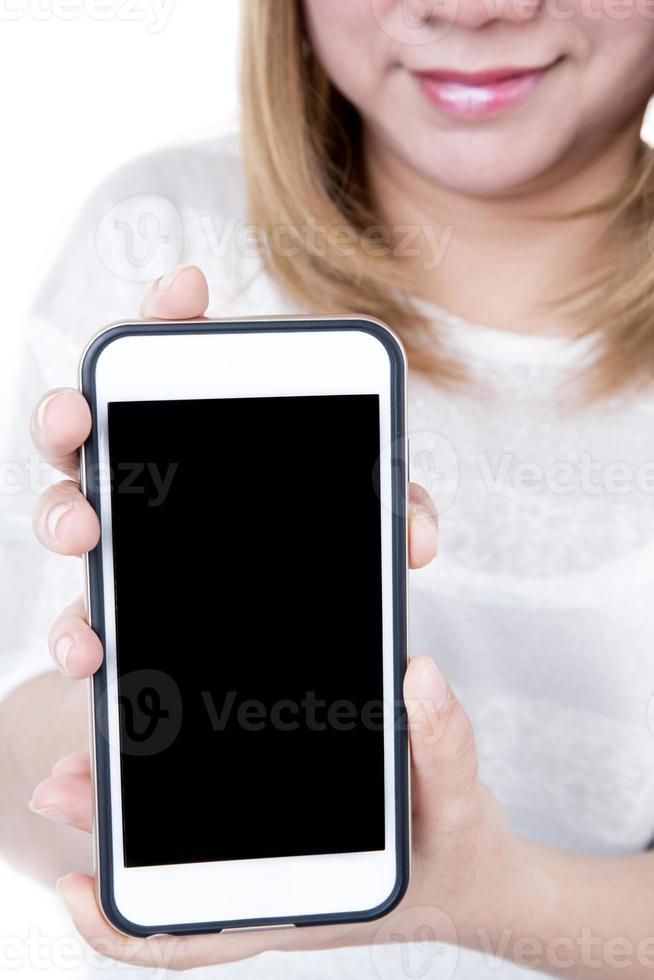 geïsoleerde vrouwelijke handen met de telefoon foto