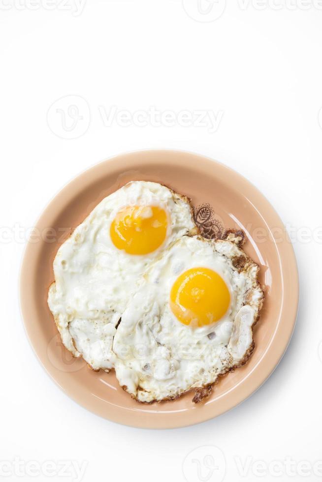 twee gebakken eieren in plaat foto