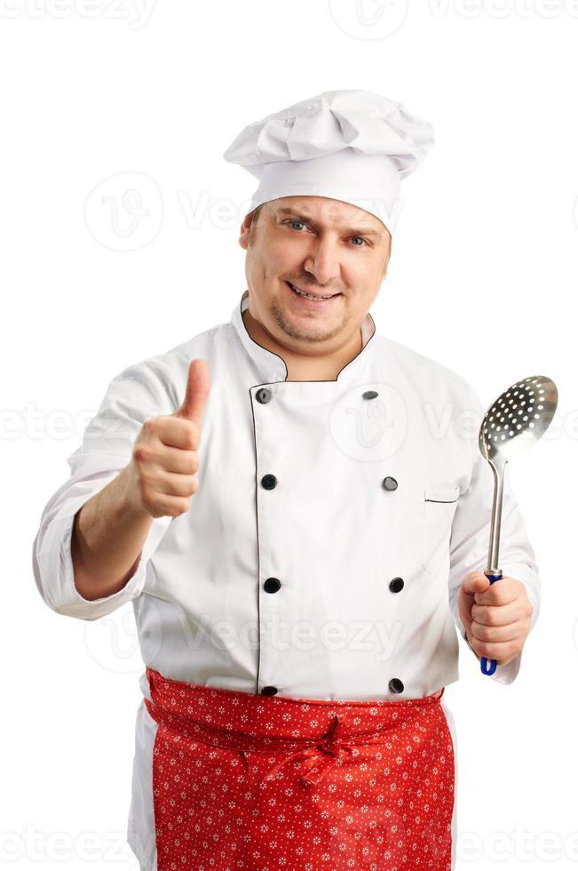 de glimlachende chef-kok geeft de duimen op foto