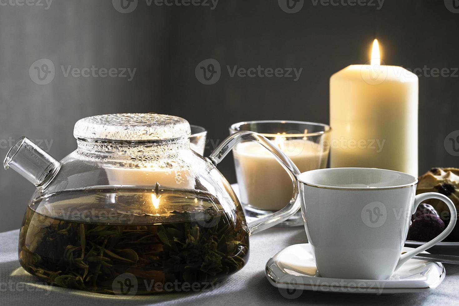 kopje thee en theepot foto