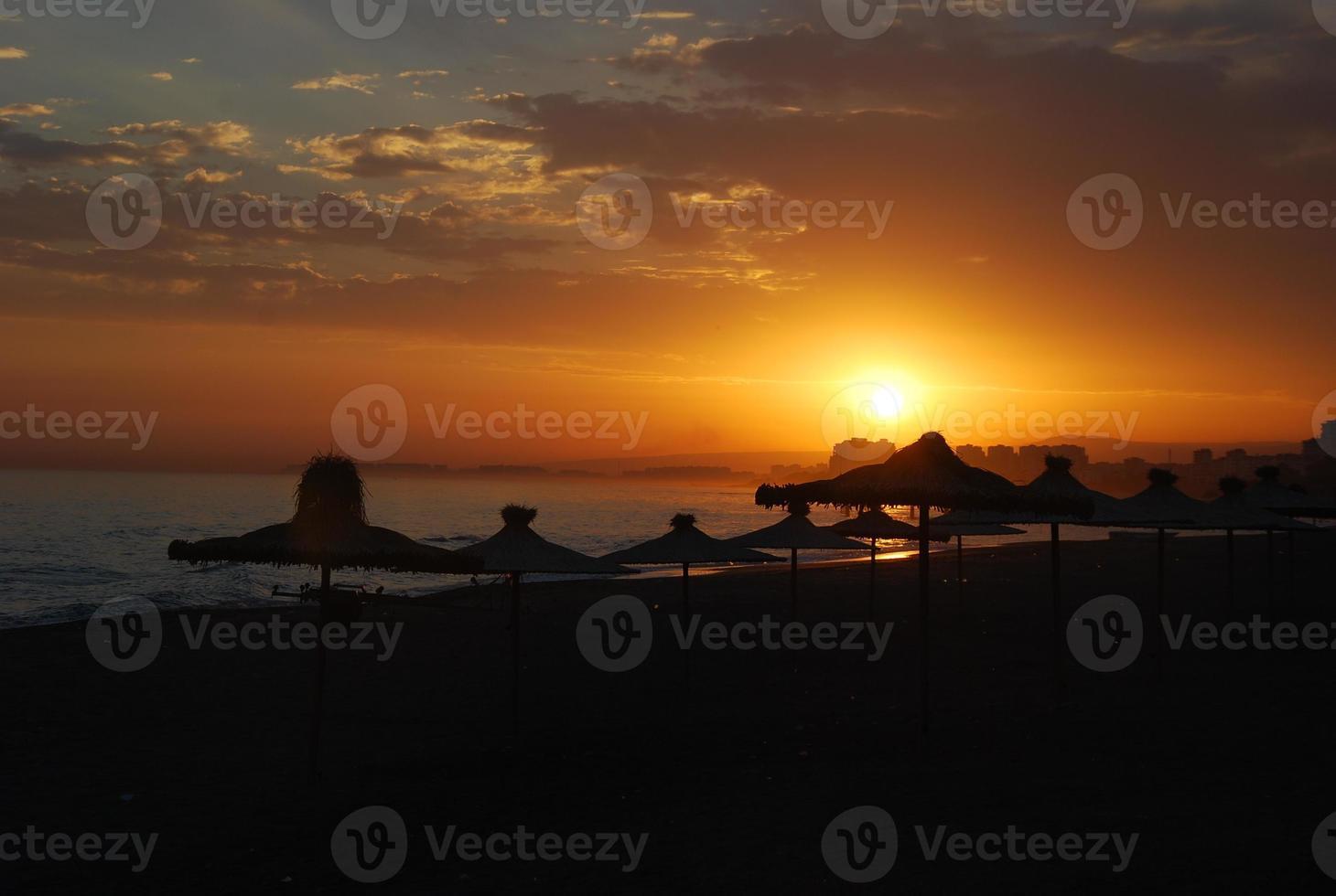 zonsondergang strand foto