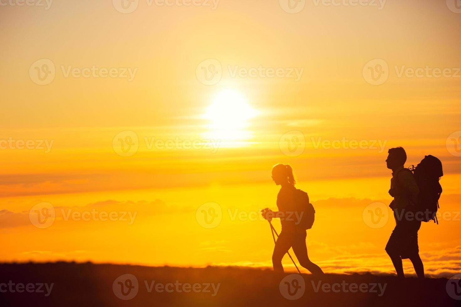 zonsondergang wandelaars foto
