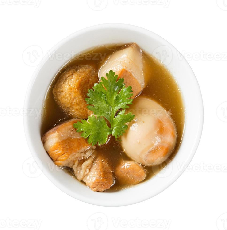 zoete pot gestoofd varkensvlees en ei met vijf kruiden foto