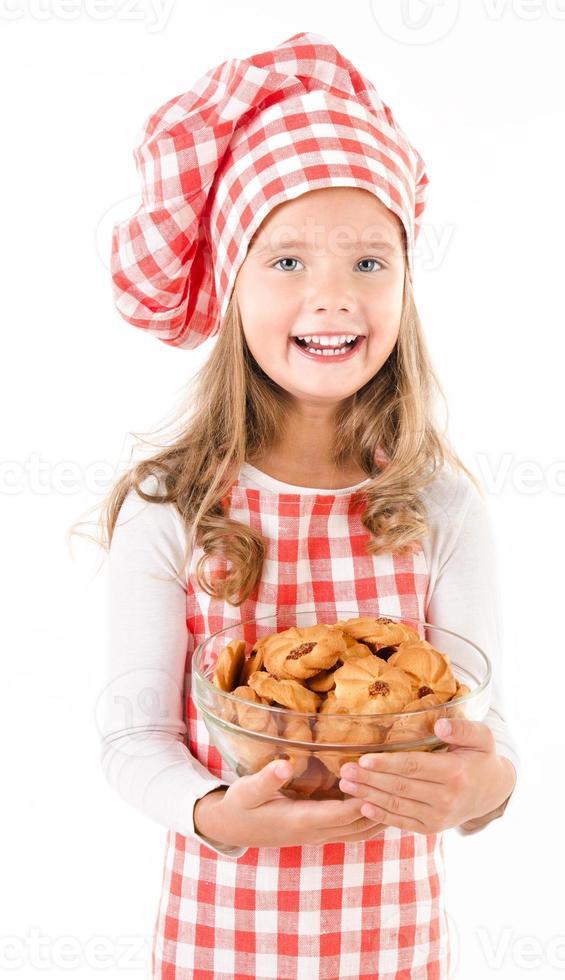 glimlachend schattig klein meisje in chef hoed foto