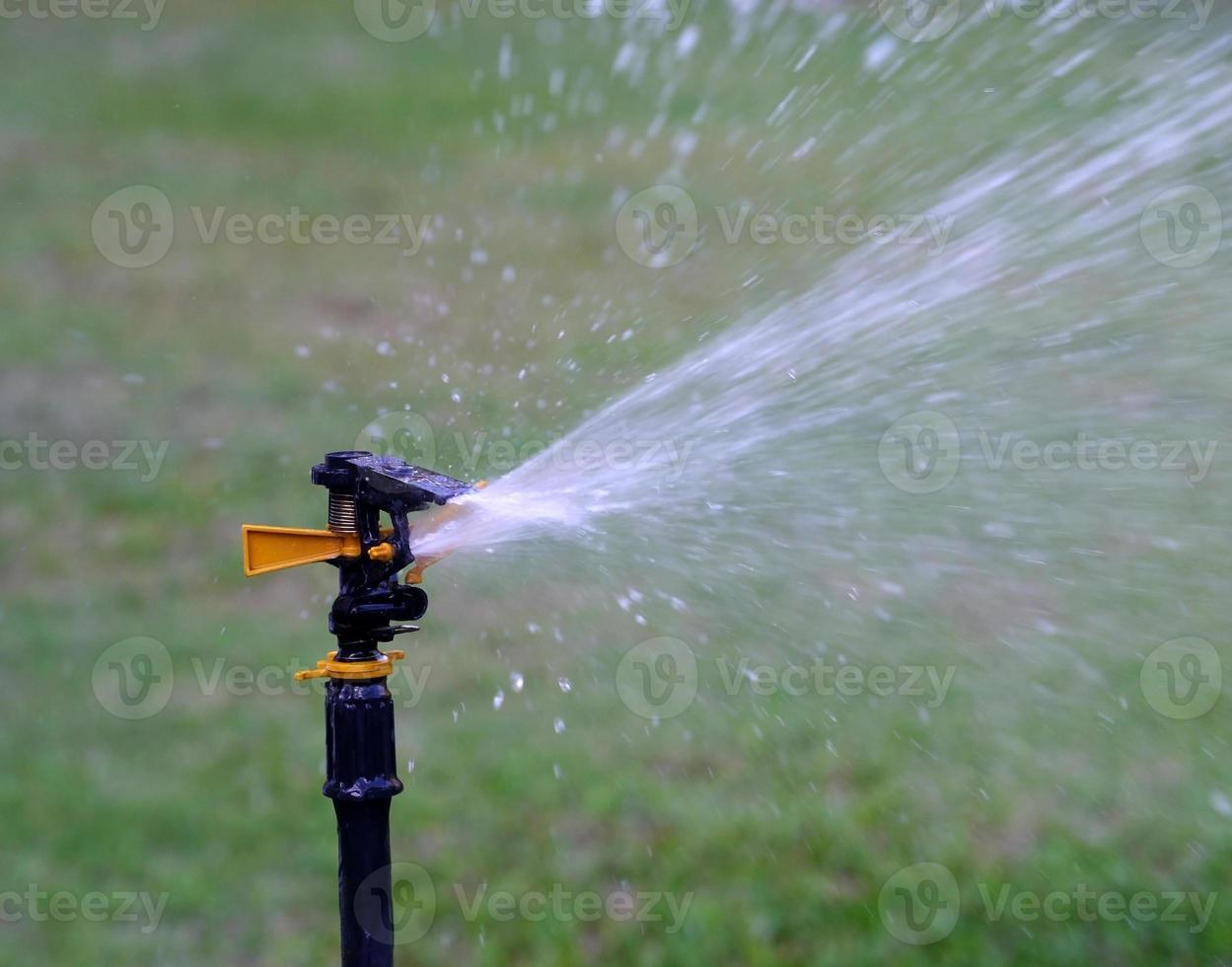 sprinkler water geven foto