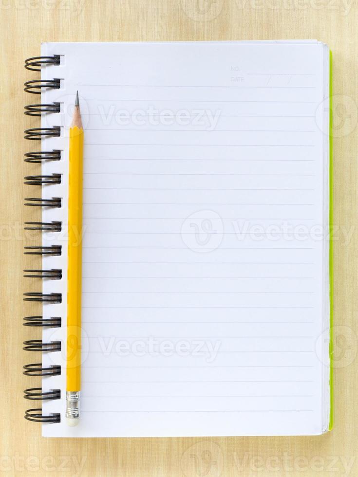 potlood en notitieboek foto