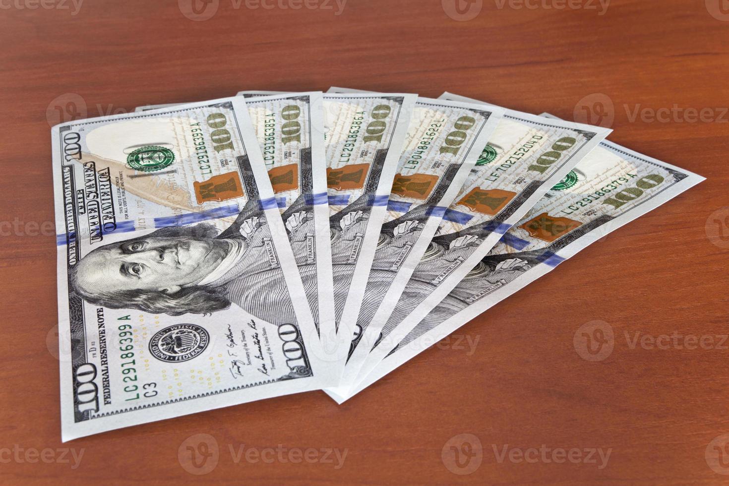 geld concept - meerdere dollar biljetten foto