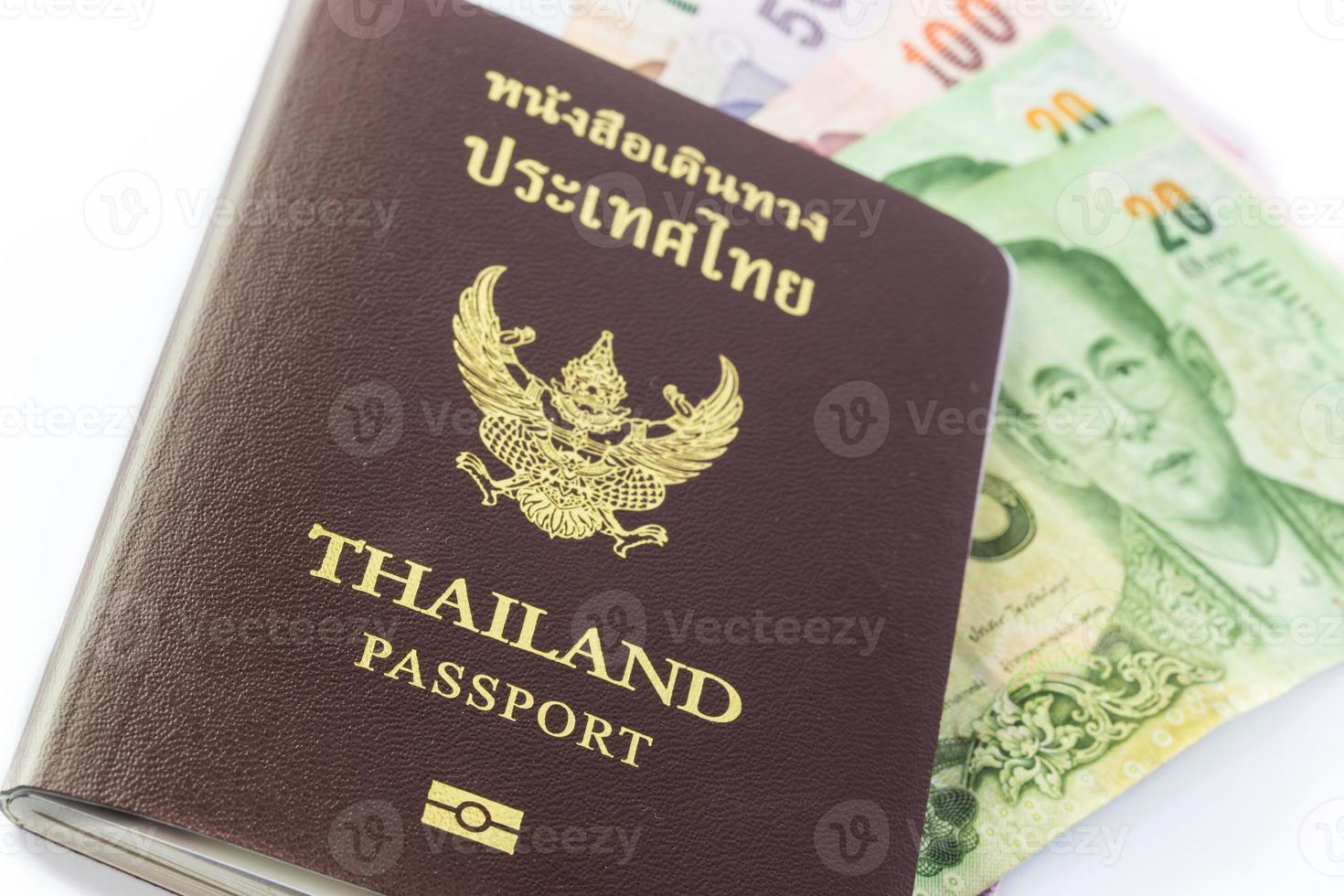 het paspoort van Thailand met Thais geld foto