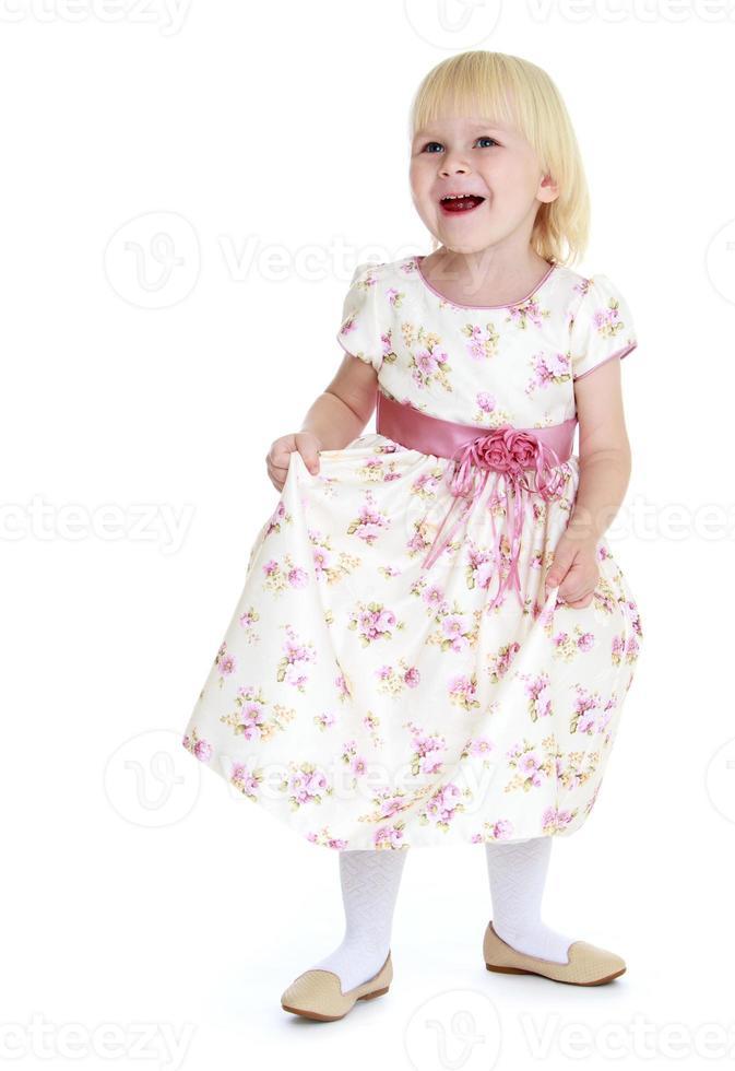 vrolijk Kaukasisch blondemeisje foto