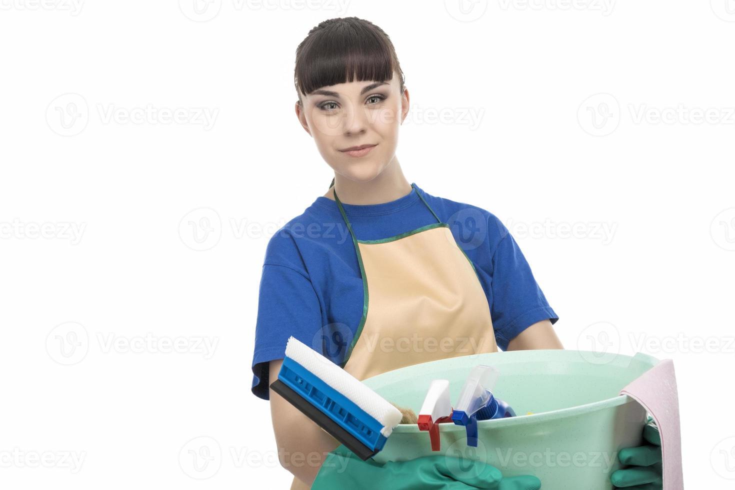 Kaukasische schonere meid vrouw met schoonmaak spullen foto