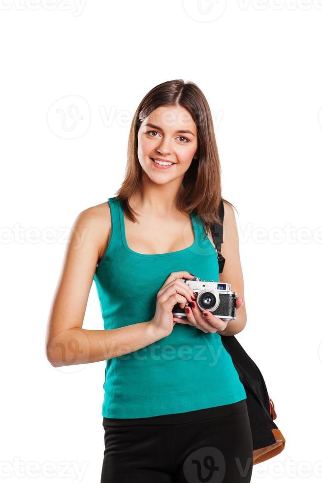 jonge blanke vrouw met camera geïsoleerd op witte achtergrond foto