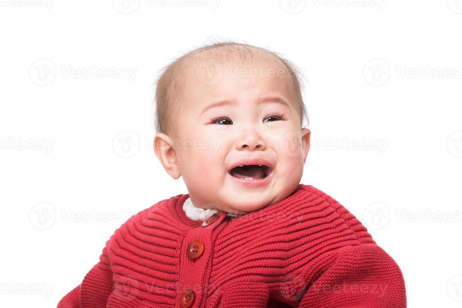 Aziatische baby huilen foto