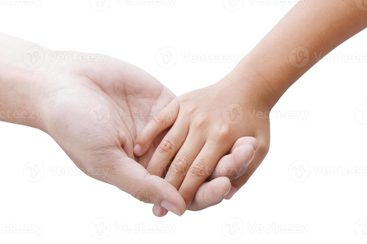 handen van vader en zoon die elkaar houden foto