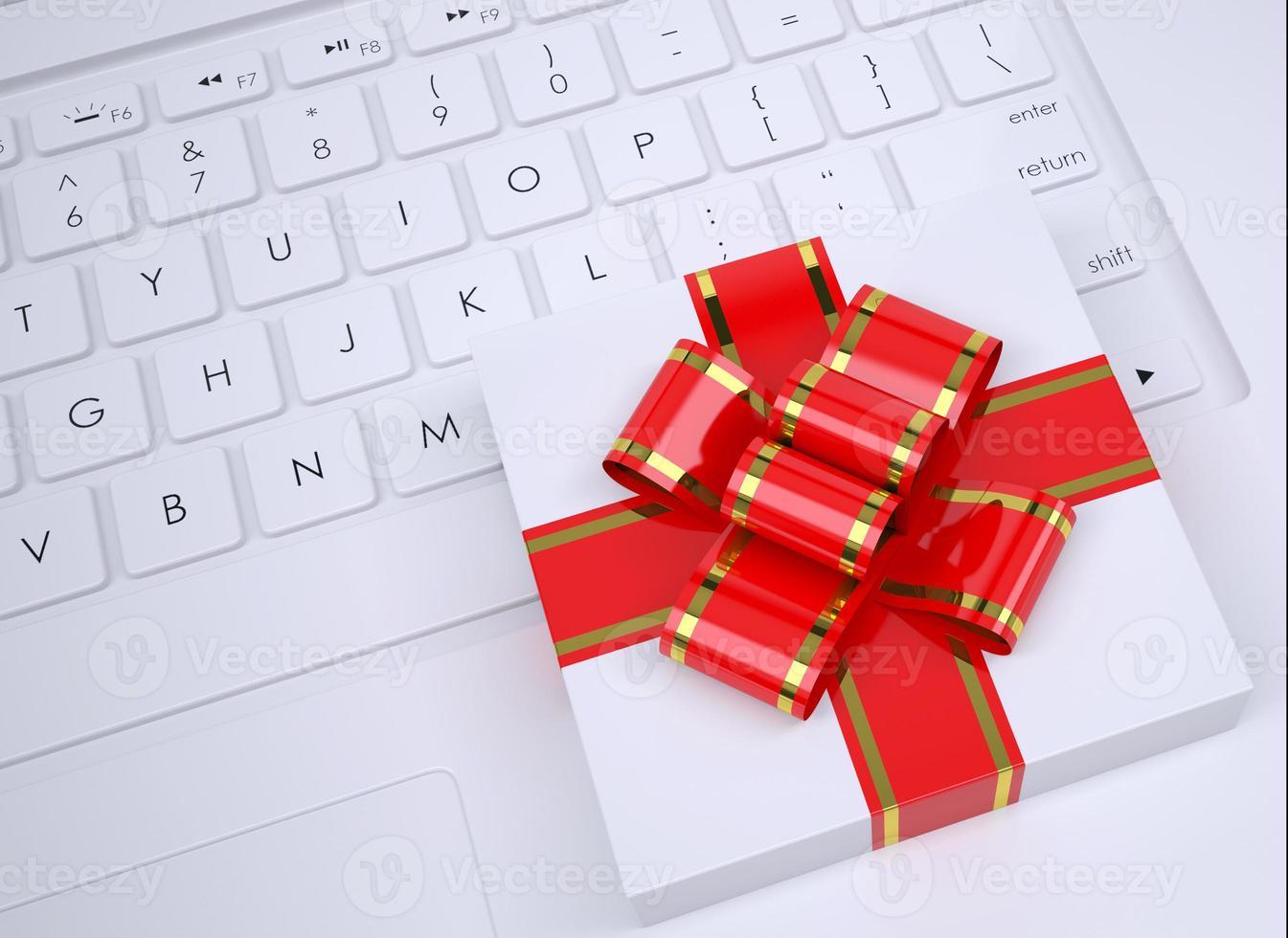 witte geschenkdoos ligt op het toetsenbord foto