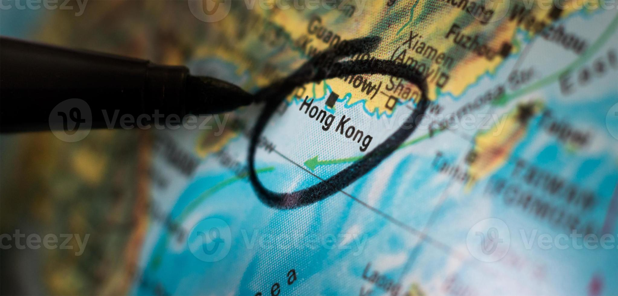 zwarte pen omcirkelt hong kong op een kaart foto