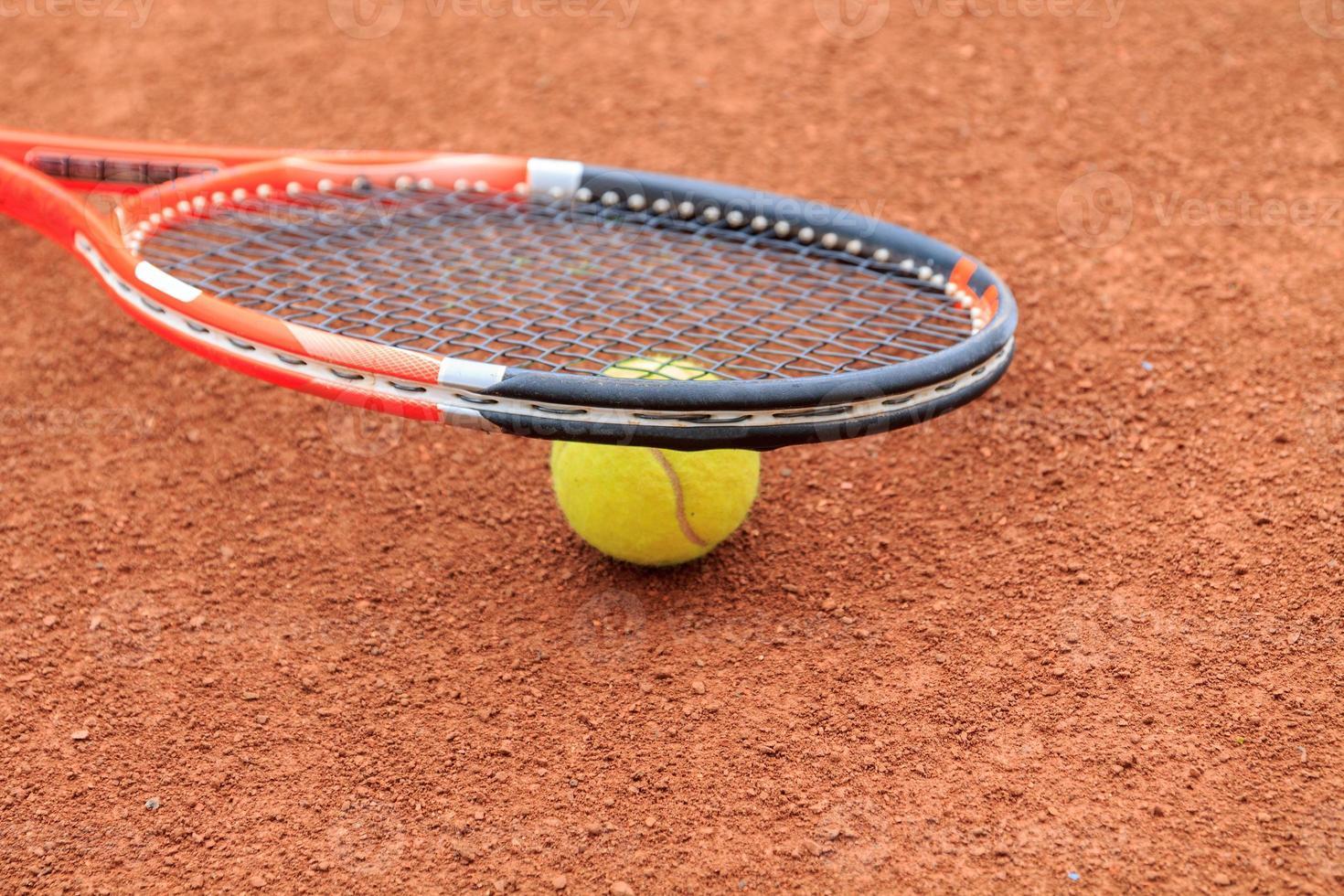 tennisbal en racket foto