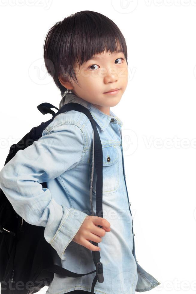 jongen met schooltas foto