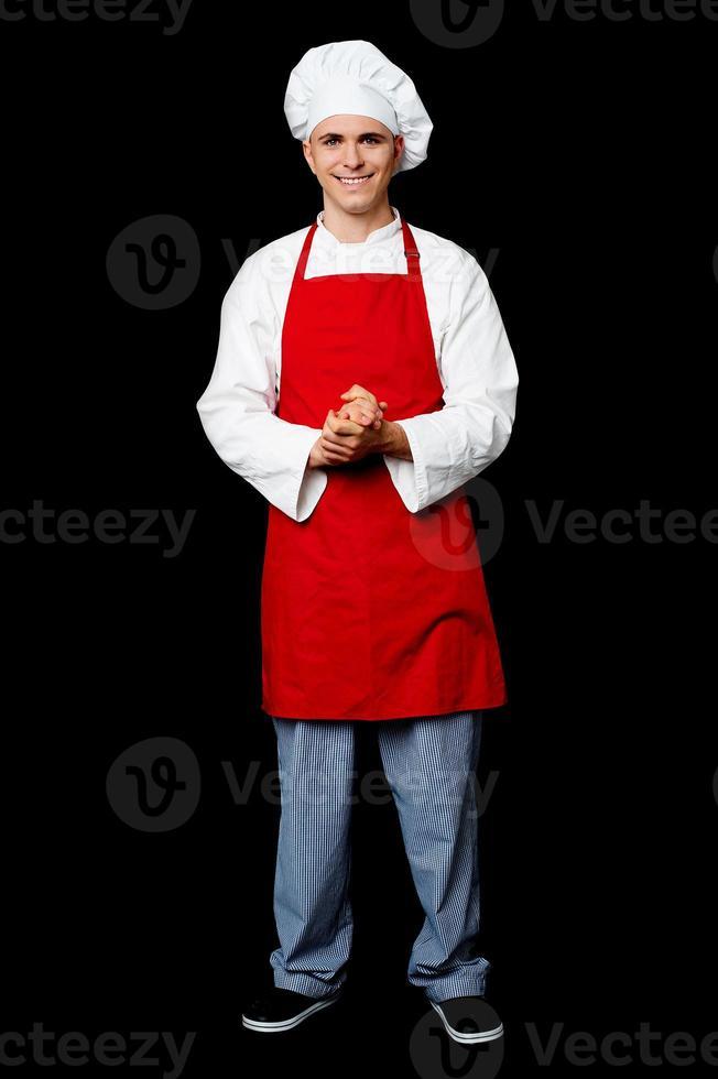 volledige lengte portret van een knappe chef-kok foto